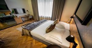 Łóżko lub łóżka w pokoju w obiekcie Urban Boutique Hotel Center