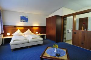 Ein Bett oder Betten in einem Zimmer der Unterkunft City Hotel Saarbrücken