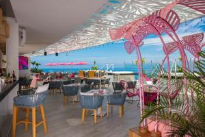 A restaurant or other place to eat at Almar Resort Luxury LGBT Beach Front Experience
