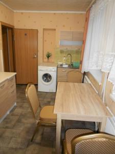A kitchen or kitchenette at Jeruzale Hotel