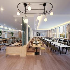 A restaurant or other place to eat at Adina Apartment Hotel Vienna Belvedere
