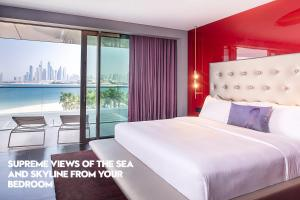 A bed or beds in a room at W Dubai - The Palm