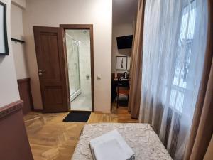 Кровать или кровати в номере AllisHotel