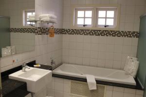 Um banheiro em Hotel Cordialle