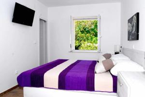 A bed or beds in a room at Forest Green