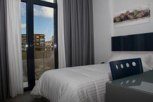 Cama o camas de una habitación en Hotel Santa Eulalia
