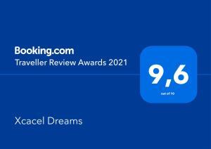 Certificado, premio, señal o documento que está expuesto en Xcacel Dreams