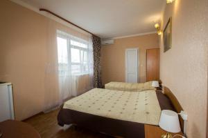 Кровать или кровати в номере Отель Каро