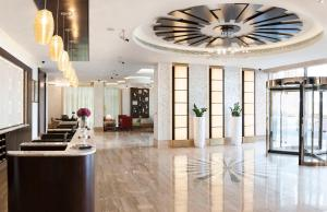The lobby or reception area at Carlton Downtown Hotel