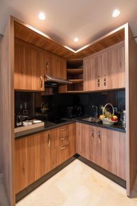 مطبخ أو مطبخ صغير في Avenue Suites