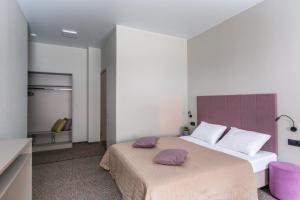Кровать или кровати в номере Norke Prime Цветной