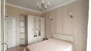 A bed or beds in a room at Апартаменты на Халтурина 30 КОМФОРТ