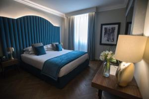 Ein Bett oder Betten in einem Zimmer der Unterkunft Antico Albergo del Sole al Pantheon