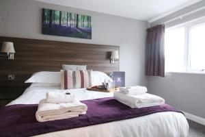 A bed or beds in a room at Foundry 34