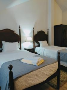 A bed or beds in a room at Blue Castle House
