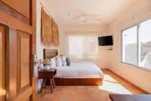 A bed or beds in a room at Mereva Tulum by Blue Sky