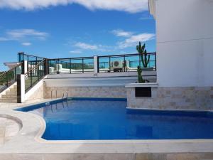 The swimming pool at or close to Lofts Prainha