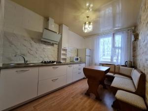 A kitchen or kitchenette at Апартаменты на Лазаренко от ApartmentCity