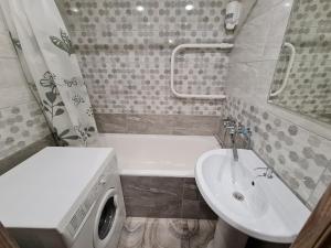 A bathroom at Апартаменты на Лазаренко от ApartmentCity