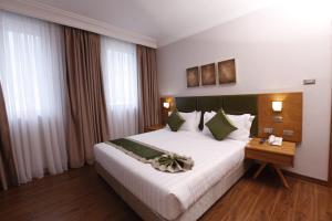 Cama o camas de una habitación en Sabon Hotel