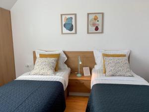 Ein Bett oder Betten in einem Zimmer der Unterkunft Apart Hotel Gardenia