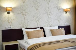 A bed or beds in a room at Hotel Zepter Palace