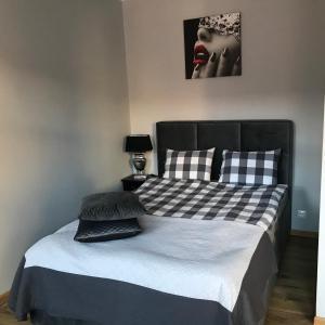 Łóżko lub łóżka w pokoju w obiekcie Apartament 52 Old Town