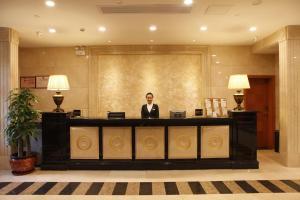 Staff members at Guangzhou Yuehai Hotel