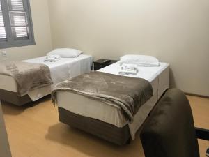 A bed or beds in a room at Pousada Convento São Lourenço