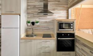 A kitchen or kitchenette at Green Garden Eco Resort & Villas