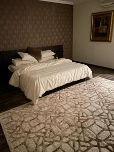 سرير أو أسرّة في غرفة في فيلا الفيروز Turquoise villa