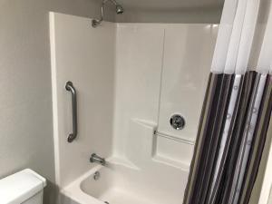 A bathroom at La Quinta by Wyndham Orlando Universal area