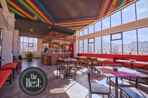 A restaurant or other place to eat at The Nest La Paz