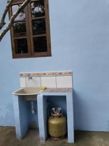 Um banheiro em Chale Das Flores