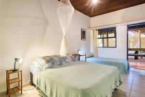 A bed or beds in a room at Residence Picinguaba