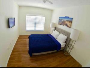 A bed or beds in a room at Family Home 10mi From Disney w/POOL