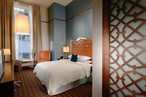 A bed or beds in a room at The Crawford Hotel at Union Station