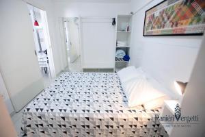 A bed or beds in a room at Paraiso, paz e conforto é aqui! Seja bem vindo(a).