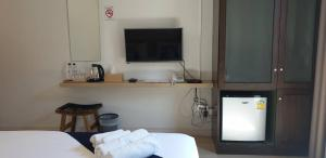 TV/Unterhaltungsangebot in der Unterkunft Pakchong Center Poshtel