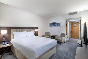 A bed or beds in a room at Hilton London Gatwick Airport