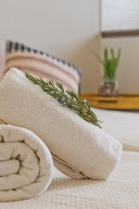 A bed or beds in a room at Kalimera Karpathos Exclusive Villas