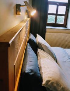 Een bed of bedden in een kamer bij Tisza Lodge