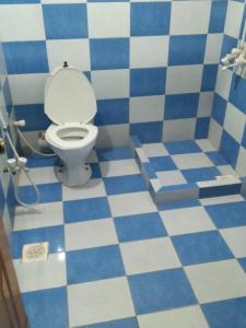 A bathroom at Tourist Inn Hotel
