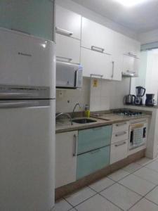 A cozinha ou cozinha compacta de Apartamento Beira Mar Floripa
