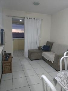Uma área de estar em Apartamento Beira Mar Floripa