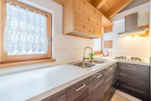 A kitchen or kitchenette at Appartamenti Al Molin