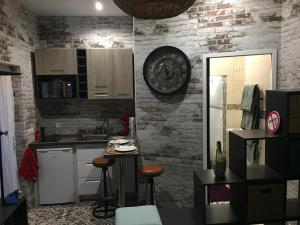 A kitchen or kitchenette at Chambre D'hôte Villa Maurice