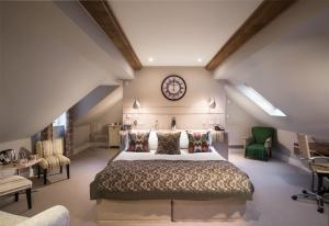 A bed or beds in a room at The Howard Arms