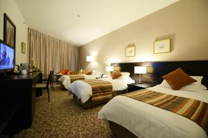 A bed or beds in a room at St. George Hotel