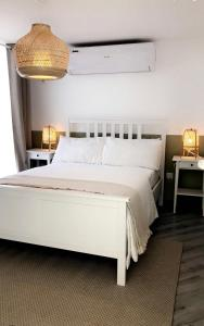 A bed or beds in a room at The Farm Chalet